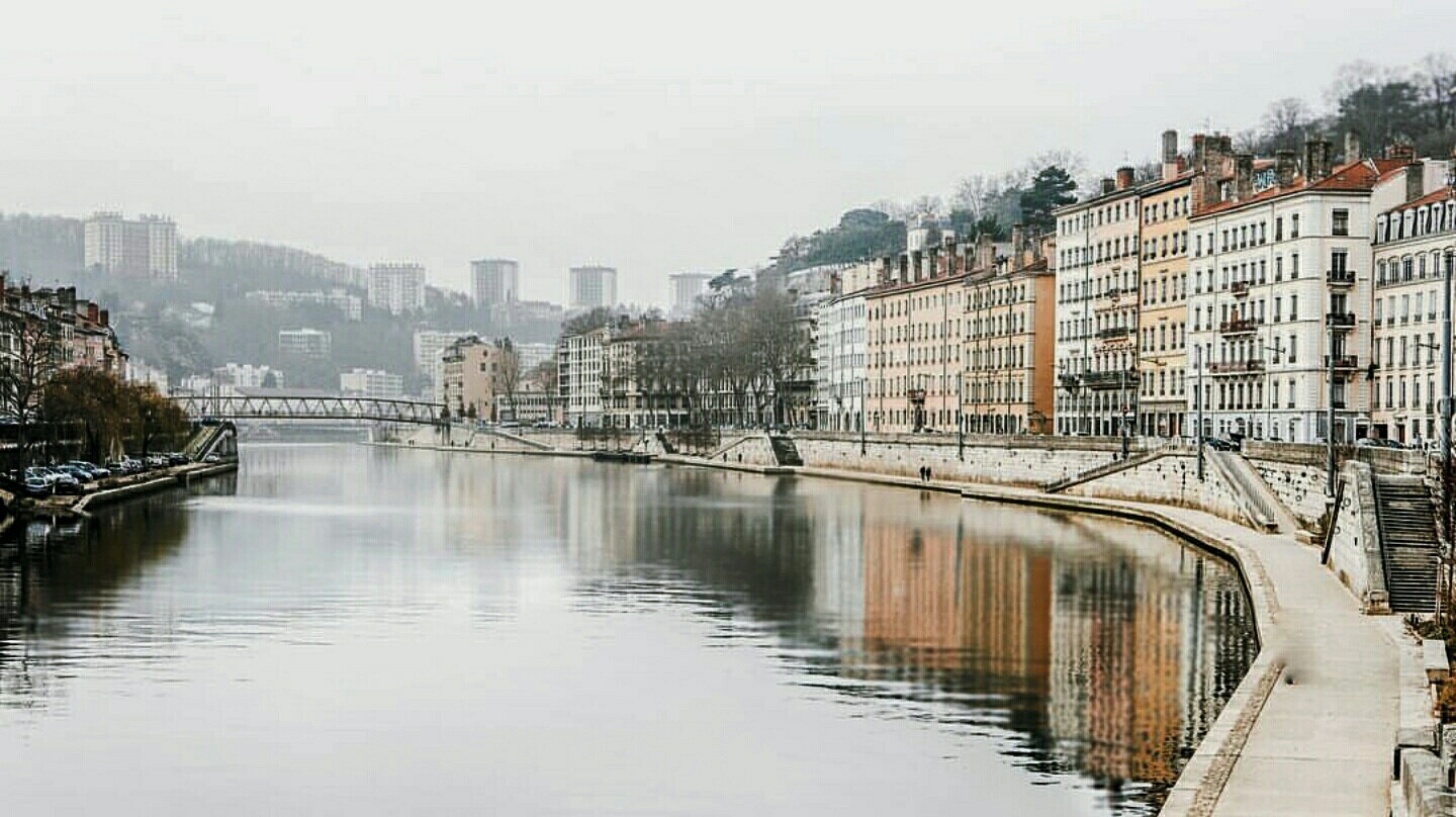 lyon river pink buildings nespresso