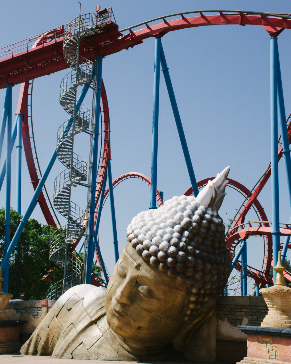 Buddha structure at Port Aventura World, Spain. Red Khan roller coaster.