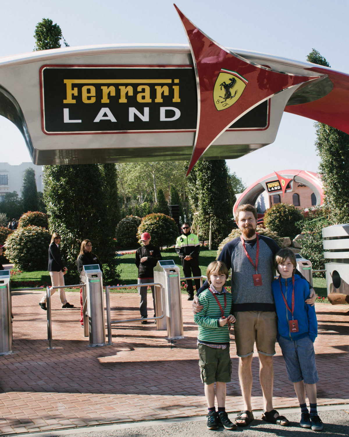 The gates of Ferrari Land and three thrilled and exhausted visitors.