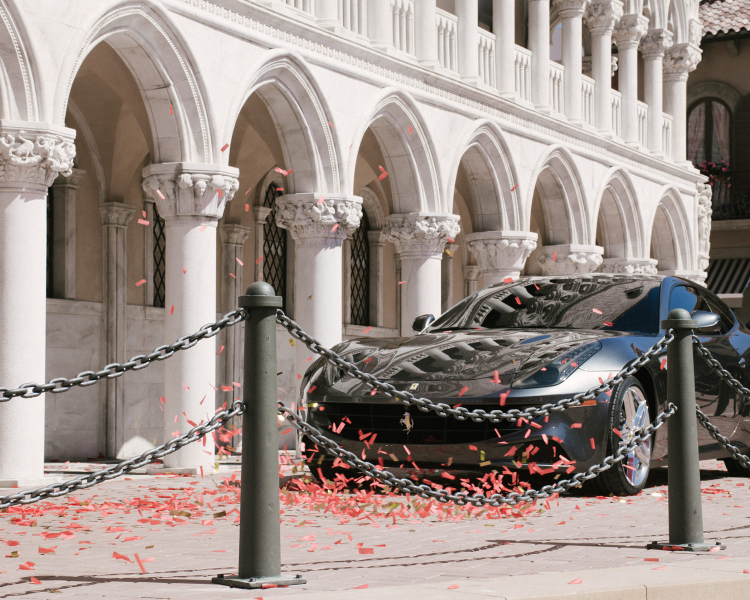 Red ticker tape blows down the recreated streets of Rome.